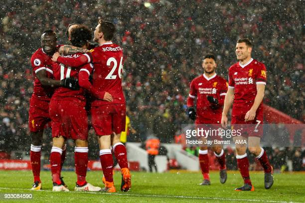 Mohamed Salah of Liverpool celebrates after scoring a goal to make it 50 during the Premier League match between Liverpool and Watford at Anfield on...