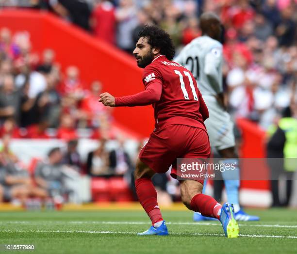 Mohamed Salah of Liverpool celebrates after scoring during the Premier League match between Liverpool FC and West Ham United at Anfield on August 12...