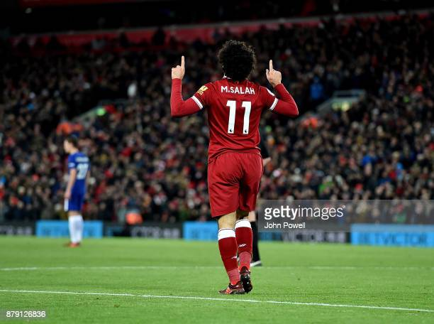 Mohamed Salah of Liverpool celebrates after scoring during the Premier League match between Liverpool and Chelsea at Anfield on November 25 2017 in...
