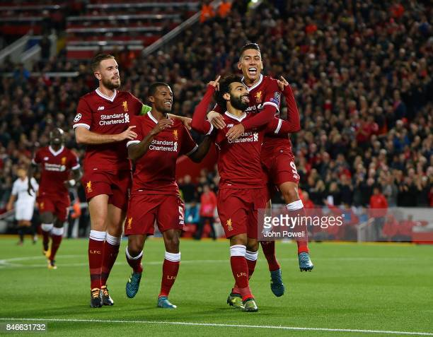 Mohamed Salah of Liverpool celebrates after scoring during the UEFA Champions League group E match between Liverpool FC and Sevilla FC at Anfield on...