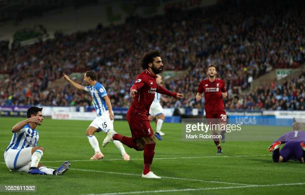 Mohamed Salah of Liverpool celebrates after scoring his sides first goal during the Premier League match between Huddersfield Town and Liverpool FC...