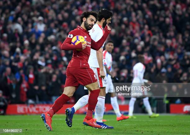 Mohamed Salah of Liverpool celebrates after scoring his sides first goal during the Premier League match between Liverpool FC and Crystal Palace at...