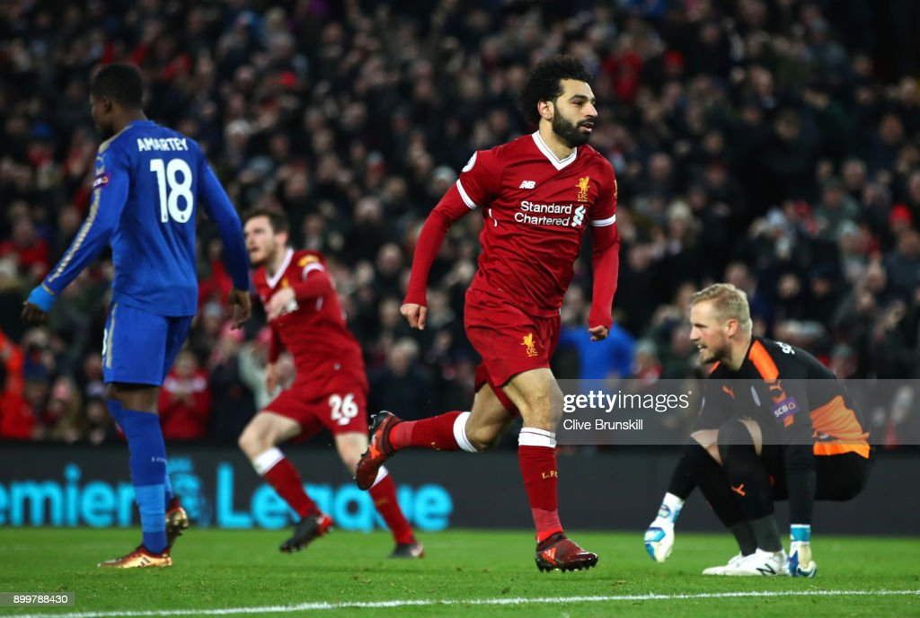 Mohamed Salah of Liverpool celebrates after scoring his sides first goal during the Premier League match between Liverpool and Leicester City at Anfield on December 30, 2017 in Liverpool, England.