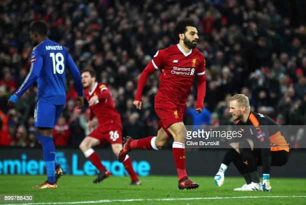 Mohamed Salah of Liverpool celebrates after scoring his sides first goal during the Premier League match between Liverpool and Leicester City at...