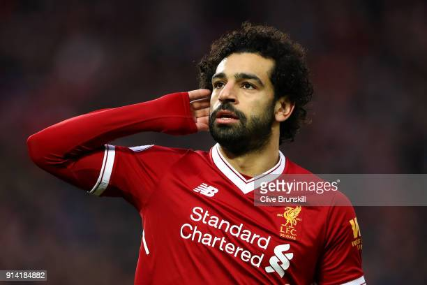 Mohamed Salah of Liverpool celebrates after scoring his sides first goal during the Premier League match between Liverpool and Tottenham Hotspur at...