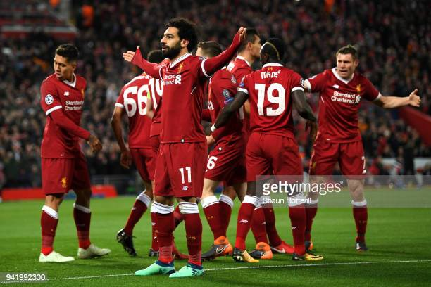 Mohamed Salah of Liverpool celebrates after scoring his sides first goal with his team mates during the UEFA Champions League Quarter Final Leg One...