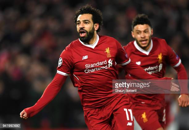 Mohamed Salah of Liverpool celebrates after scoring his sides first goal during the UEFA Champions League Quarter Final Leg One match between...