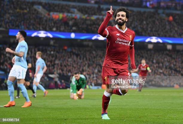 Mohamed Salah of Liverpool celebrates after scoring his sides first goal during the UEFA Champions League Quarter Final Second Leg match between...