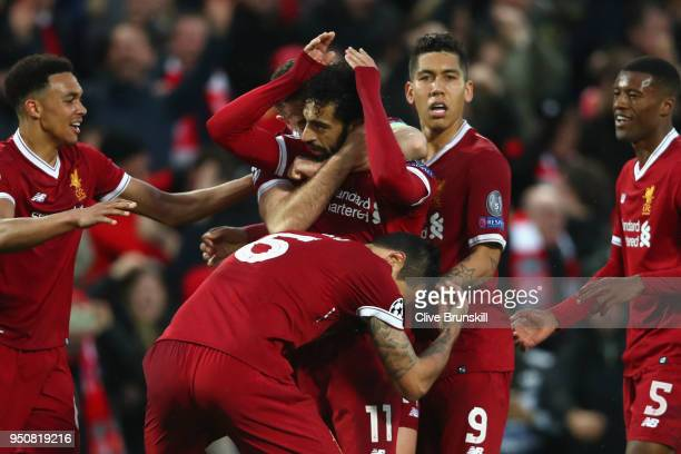 Mohamed Salah of Liverpool celebrates after scoring his sides first goal with team mates during the UEFA Champions League Semi Final First Leg match...