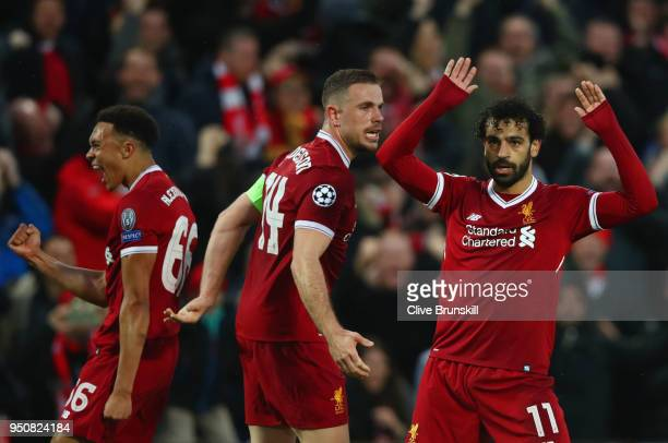 Mohamed Salah of Liverpool celebrates after scoring his sides first goal with team mates Jordan Henderson and Trent Alex Arnold of Liverpool during...