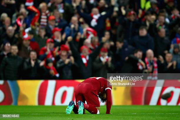 Mohamed Salah of Liverpool celebrates after scoring his sides first goal during the UEFA Champions League Semi Final First Leg match between...
