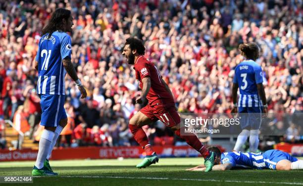 Mohamed Salah of Liverpool celebrates after scoring his sides first goal during the Premier League match between Liverpool and Brighton and Hove...