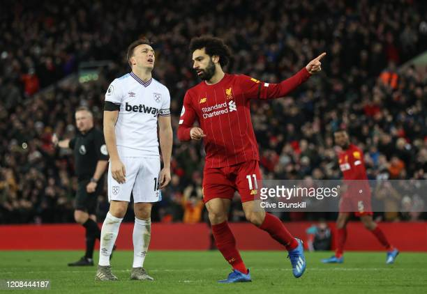 Mohamed Salah of Liverpool celebrates after scoring his sides second goal during the Premier League match between Liverpool FC and West Ham United at...