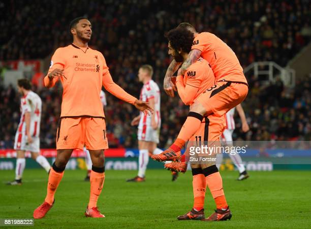 Mohamed Salah of Liverpool celebrates after scoring his sides second goal with Joe Gomez of Liverpool during the Premier League match between Stoke...