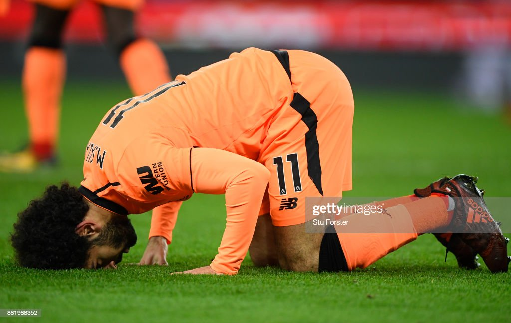Mohamed Salah of Liverpool celebrates after scoring his sides second goal during the Premier League match between Stoke City and Liverpool at Bet365 Stadium on November 29, 2017 in Stoke on Trent, England.