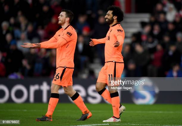 Mohamed Salah of Liverpool celebrates after scoring his sides second goal with Andy Robertson of Liverpool during the Premier League match between...