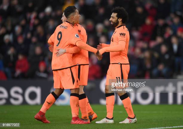 Mohamed Salah of Liverpool celebrates after scoring his sides second goal with Roberto Firmino of Liverpool and Andy Robertson of Liverpool during...