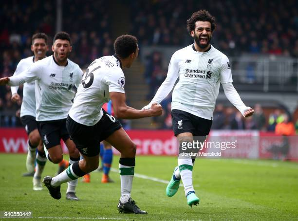 Mohamed Salah of Liverpool celebrates after scoring his sides second goal during the Premier League match between Crystal Palace and Liverpool at...