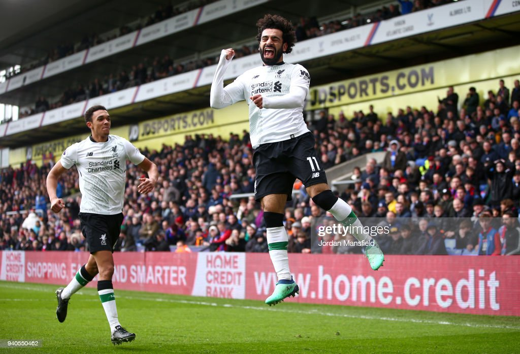 Mohamed Salah of Liverpool celebrates after scoring his sides second goal during the Premier League match between Crystal Palace and Liverpool at Selhurst Park on March 31, 2018 in London, England.