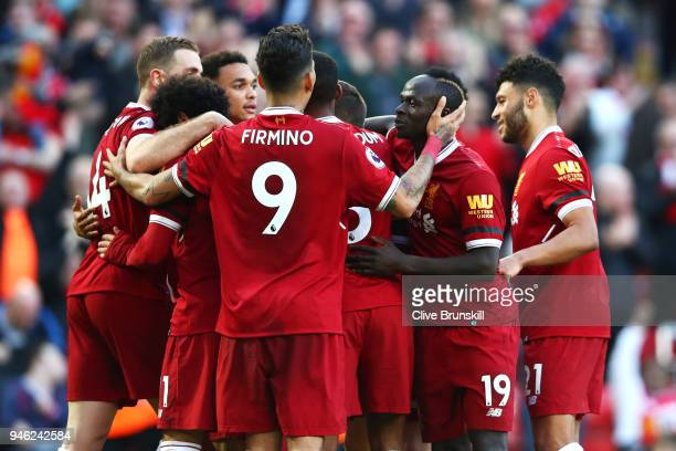 Mohamed Salah of Liverpool celebrates after scoring his sides second goal with his Liverpool team mates during the Premier League match between...