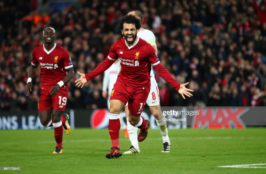 Mohamed Salah of Liverpool celebrates after scoring his sides seventh goal during the UEFA Champions League group E match between Liverpool FC and Spartak Moskva at Anfield on December 6, 2017 in Liverpool, United Kingdom.