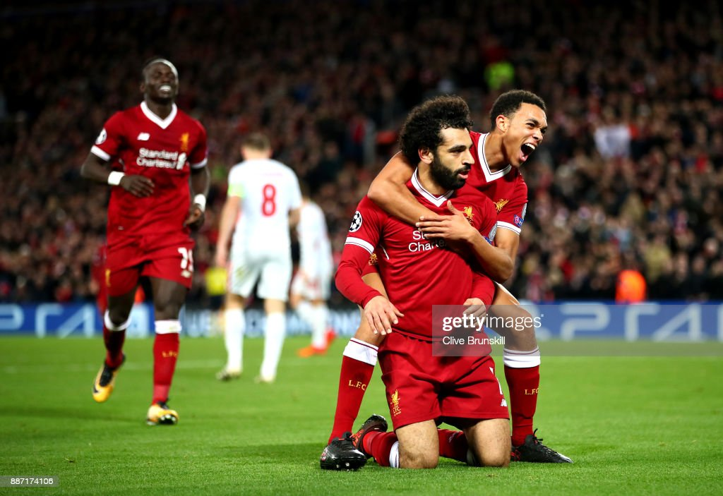 Mohamed Salah of Liverpool celebrates after scoring his sides seventh goal with Trent Alex Arnold of Liverpool during the UEFA Champions League group E match between Liverpool FC and Spartak Moskva at Anfield on December 6, 2017 in Liverpool, United Kingdom.