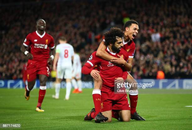 Mohamed Salah of Liverpool celebrates after scoring his sides seventh goal with Trent Alex Arnold of Liverpool during the UEFA Champions League group...