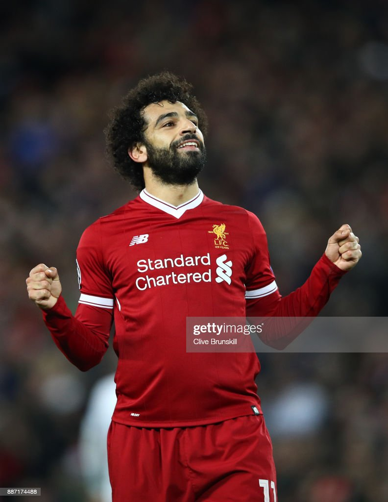 Mohamed Salah of Liverpool celebrates after scoring his sides sixth goal during the UEFA Champions League group E match between Liverpool FC and Spartak Moskva at Anfield on December 6, 2017 in Liverpool, United Kingdom.