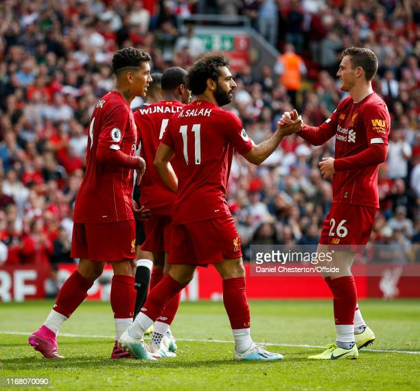 Mohamed Salah of Liverpool celebrates after scoring his side's third goal to make the score 3-1 during the Premier League match between Liverpool FC...