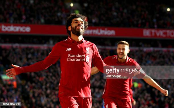 Mohamed Salah of Liverpool celebrates after scoring his team's first goal during the Premier League match between Liverpool FC and Cardiff City at...