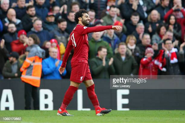 Mohamed Salah of Liverpool celebrates after scoring his team's first goal during the Premier League match between Liverpool FC and Fulham FC at...