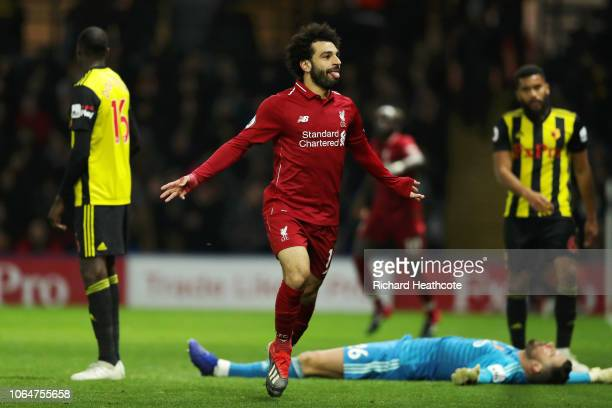 Mohamed Salah of Liverpool celebrates after scoring his team's first goal during the Premier League match between Watford FC and Liverpool FC at...