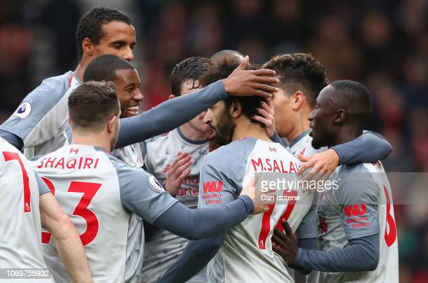 Mohamed Salah of Liverpool celebrates after scoring his team's first goal with his team mates during the Premier League match between AFC Bournemouth...
