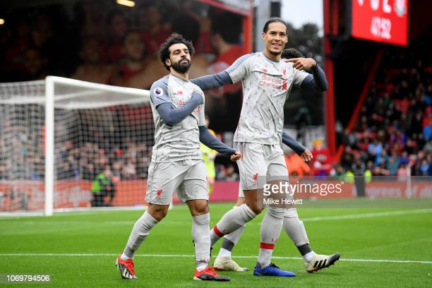 Mohamed Salah of Liverpool celebrates after scoring his team's first goal with Virgil van Dijk of Liverpool during the Premier League match between...