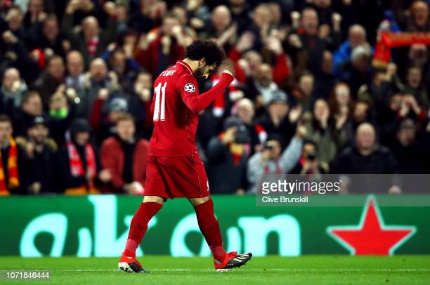 Mohamed Salah of Liverpool celebrates after scoring his team's first goal during the UEFA Champions League Group C match between Liverpool and SSC...