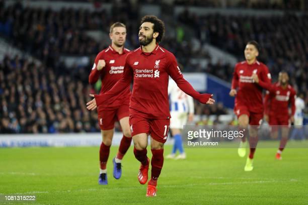 Mohamed Salah of Liverpool celebrates after scoring his team's first goal from the penalty spot during the Premier League match between Brighton Hove...