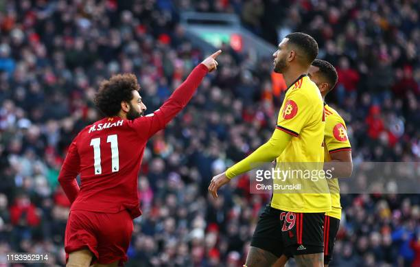 Mohamed Salah of Liverpool celebrates after scoring his teams first goal during the Premier League match between Liverpool FC and Watford FC at...