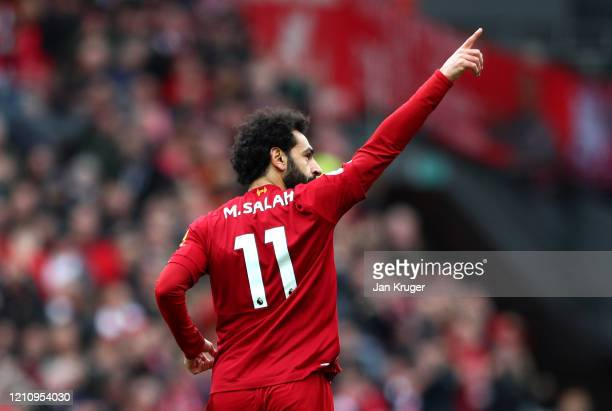 Mohamed Salah of Liverpool celebrates after scoring his team's first goal during the Premier League match between Liverpool FC and AFC Bournemouth at...