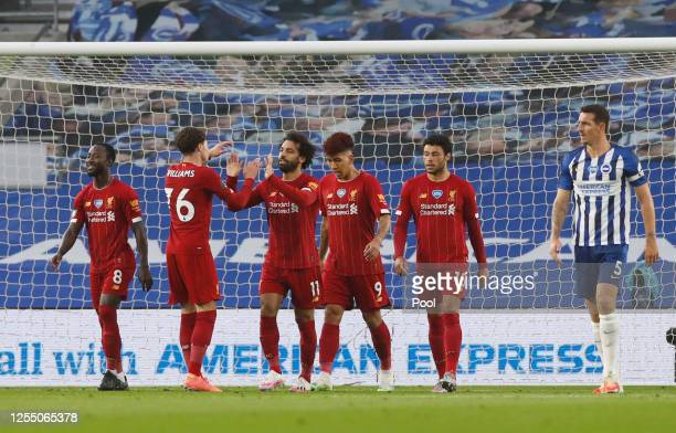 Mohamed Salah of Liverpool celebrates after scoring his teams first goal during the Premier League match between Brighton & Hove Albion and Liverpool...