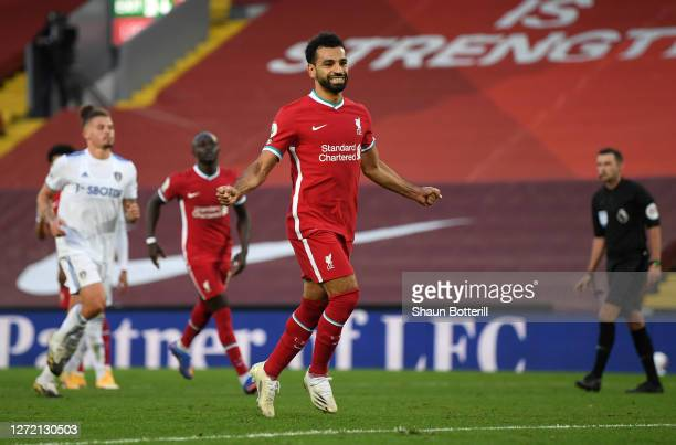Mohamed Salah of Liverpool celebrates after scoring his team's fourth goal during the Premier League match between Liverpool and Leeds United at...