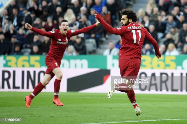 Mohamed Salah of Liverpool celebrates after scoring his team's second goal during the Premier League match between Newcastle United and Liverpool FC...