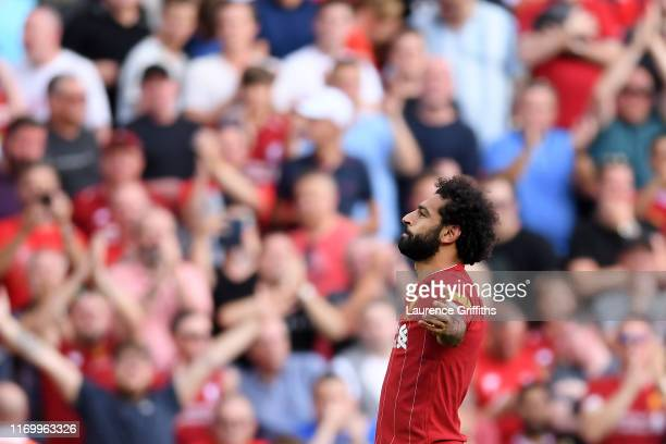 Mohamed Salah of Liverpool celebrates after scoring his team's second goal during the Premier League match between Liverpool FC and Arsenal FC at...