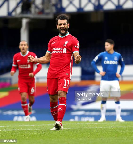 Mohamed Salah of Liverpool celebrates after scoring his team's second goal during the Premier League match between Everton and Liverpool at Goodison...