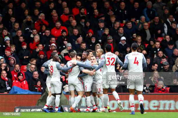 Mohamed Salah of Liverpool celebrates after scoring his team's seond goal with his team mates during the Premier League match between AFC Bournemouth...