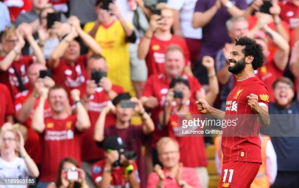 Mohamed Salah of Liverpool celebrates after scoring his team's third goal during the Premier League match between Liverpool FC and Arsenal FC at...