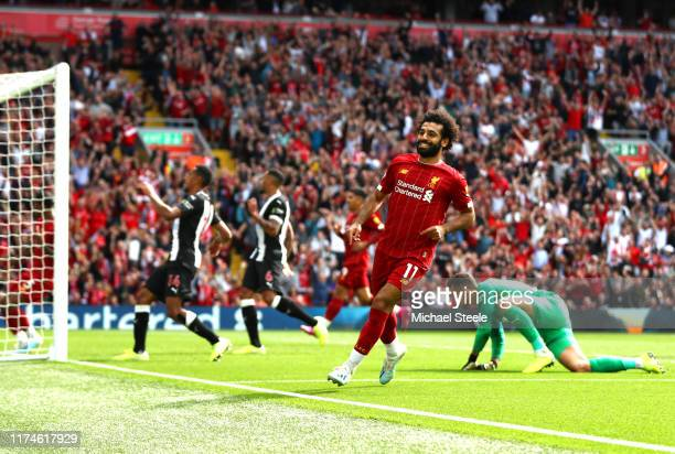 Mohamed Salah of Liverpool celebrates after scoring his team's third goal during the Premier League match between Liverpool FC and Newcastle United...