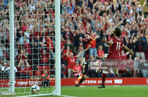 Mohamed Salah of Liverpool celebrates after scoring his team's third goal during the Premier League match between Liverpool and Arsenal at Anfield on...