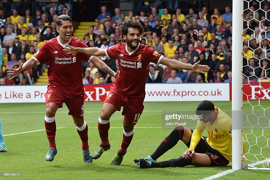 Mohamed Salah of Liverpool Celebrates after scoring liverpools third during the Premier League match between Watford and Liverpool at Vicarage Road on August 12, 2017 in Watford, England.