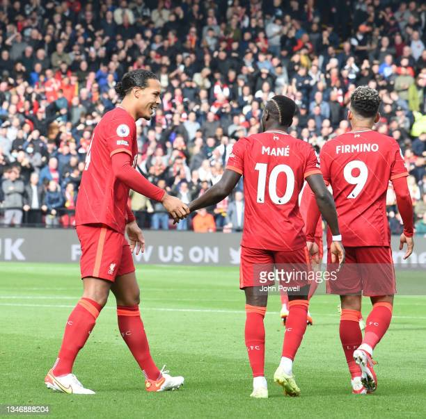 Mohamed Salah of Liverpool celebrates after scoring the first goal during the Premier League match between Watford and Liverpool at Vicarage Road on...