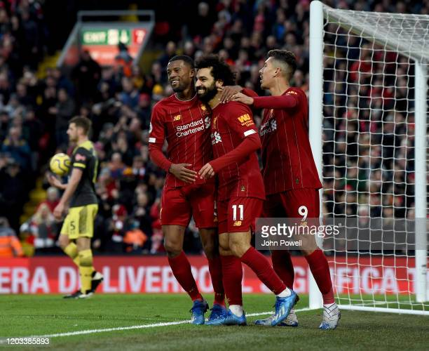 Mohamed Salah of Liverpool celebrates after scoring the fourth goal during the Premier League match between Liverpool FC and Southampton FC at...
